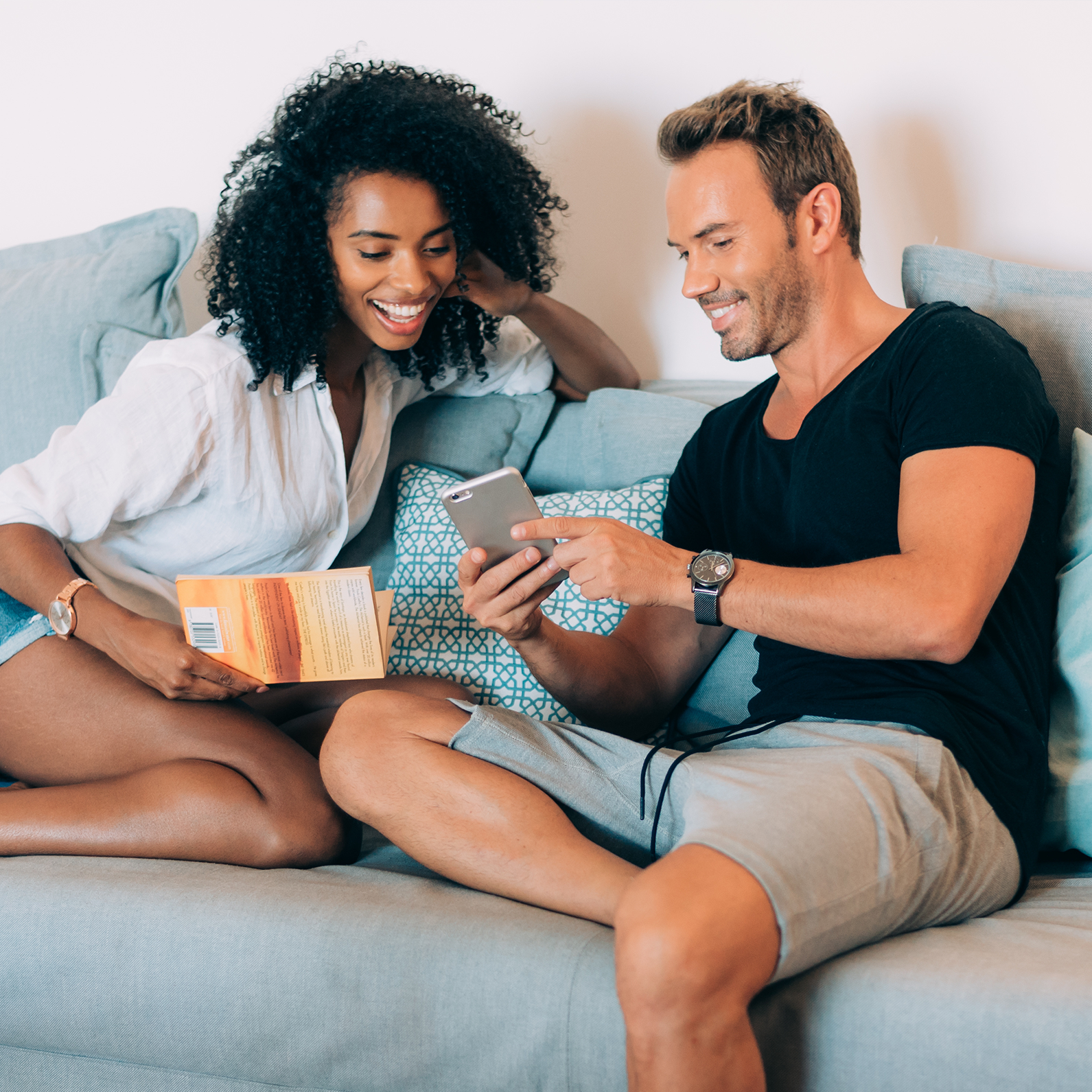 couple on sofa looking at phone