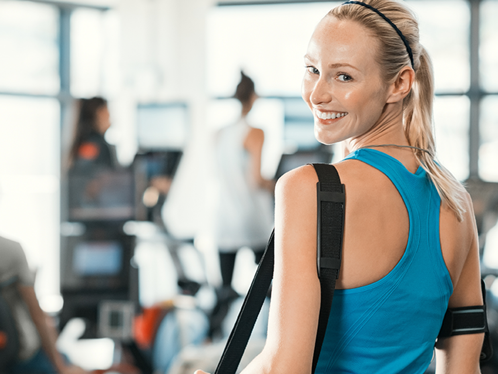 woman in gym with bag